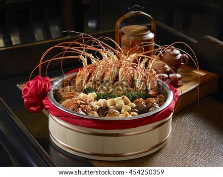 Singapore's auspicious dishes of seafood with shrimp mussels clams and crab - stock photo