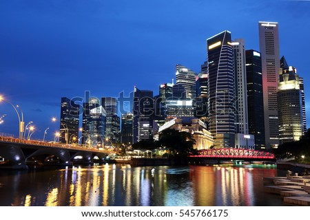 Singapore's financial district at night around the mouth of Singapore River