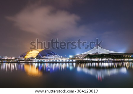 Singapore's new National Stadium illuminated at night in after rain weather - stock photo