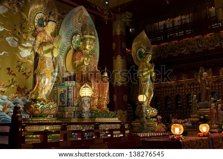 SINGAPORE - SEP 08: Buddha tooth relic temple and museum interior on Sep 08, 2013 in Singapore. Since opening in 2007, the temple has become a popular attraction within Chinatown. - stock photo