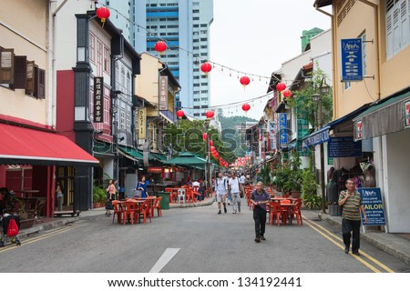 SINGAPORE - SEP 08:  Chinatown pedestrian street scene with outdoor cafes and shops on on Sep 08, 2013 in Singapore. Chinatown is the traditional Chinese quarters of Singapore.