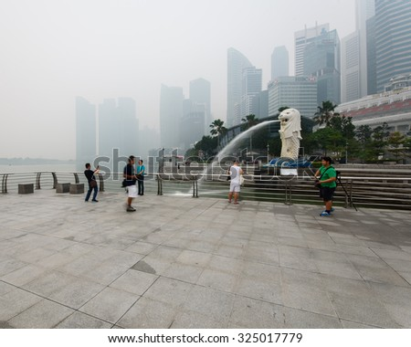 SINGAPORE-SEP 24, 2015: Haze fills the Marina Bay area. Haze is caused by the forest fire and burning of plantation in Indonesia. Also visible is the Central Business District (CBD),financial downtown