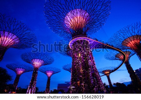 SINGAPORE - SEPT 14: Night view of Supertree Grove at Gardens by the Bay on Sept 14, 2013 in Singapore. Spanning 101 hectares of reclaimed land in central Singapore, adjacent to the Marina Reservoir. - stock photo