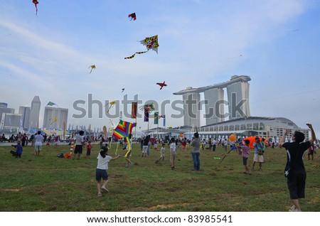SINGAPORE - SEPTEMBER 3: Kite festival, a gathering for kite enthusiast at Marina Bay September 3, 2011 in Singapore. - stock photo