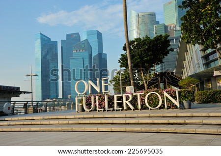 SINGAPORE - SEPTEMBER 8: The Fullerton Hotel Singapore on September 8, 2014 in Singapore. The Fullerton Hotel Singapore is a five-star boutique hotel with address 1 Fullerton Square.  - stock photo