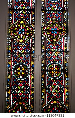 SINGAPORE-SEPTEMBER 9 : The stained glass windows with religious motifs at St. Andrew's Cathedral in Singapore on September 9, 2012 - stock photo