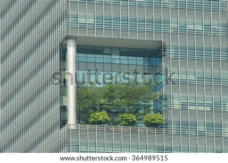 SINGAPORE, SINGAPORE - AUGUST 05, 2008: Exterior detail with the high elevated terrace at the modern building in Singapore, Singapore.  - stock photo
