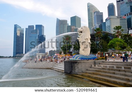 SINGAPORE, SINGAPORE - AUGUST 4: The Merlion statue is a marketing icon of Singapore depicted as a mythical creature with a lion's head and a body of a fish. Singapore, Singapore - August 4, 2014