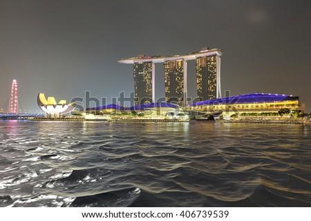 SINGAPORE, SINGAPORE -circa August,2015: Singapore city lights, ArtScience Museum, Marina Bay Sands and Helix Bridge at night, Singapore - stock photo