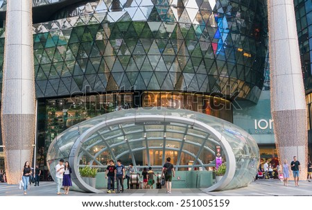 SINGAPORE, SINGAPORE - JANUARY 24: ION Orchard shopping mall on Jan 24, 2015 in Singapore. ION Orchard has 335 food and retail outlets, and it brings together the world's best-loved brands. - stock photo