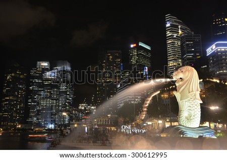 Singapore, Singapore - May 15, 2015: The Merlion fountain with fog flare effect Marina Bay in Singapore  on May 15,2015. - stock photo