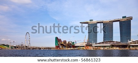 SINGAPORE, SINGAPORE - MAY 4: The new Marina Bay Sands resort and the Singapore Flyer ferris wheel on a late afternoon. Taken on May 4, 2010 in Singapore - stock photo