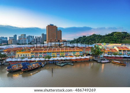Singapore, Singapore - September 18, 2016 : Colorful light building at night in Clarke Quay, Singapore. It is a historical riverside quay in Singapore, located within the Singapore River Area.
