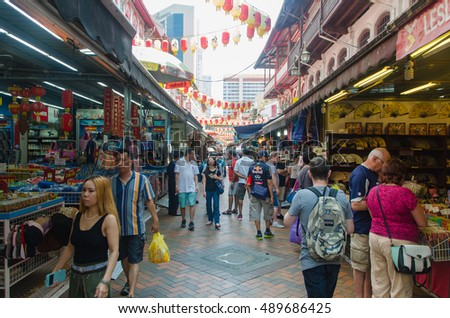 singapore, singapore - September 20, 2014: Crowds walk through a Chinatown market  in singapore