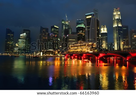 Singapore skyline and river at blue hour - stock photo