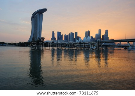 Singapore skyline and river at golden sunset - stock photo