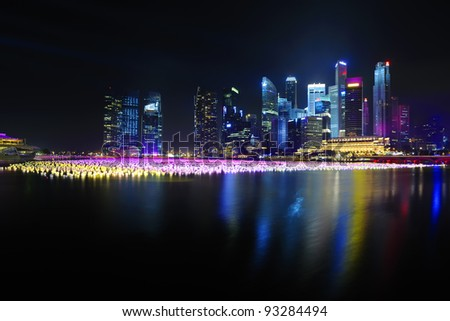 Singapore skyline and river at night - stock photo