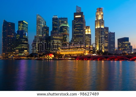 Singapore skyline and river in evening - stock photo