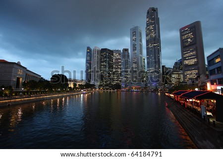 Singapore skyline, Asia. Evening urban view. Logos and names on skyscrapers removed. - stock photo