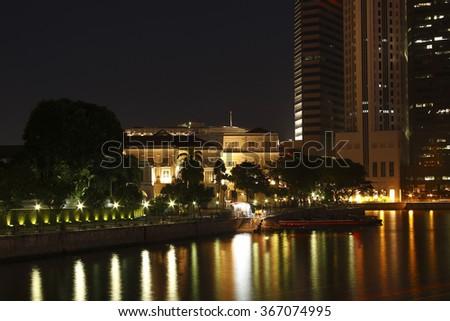 Singapore skyline at night with cavenagh-bridge and urban buildings,Singapore,Asia - stock photo