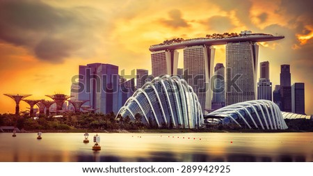 Singapore skyline at sunset with skyscrapers - stock photo