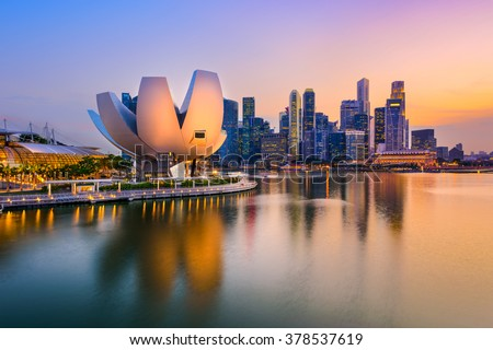 Singapore skyline at the Marina during twilight. - stock photo