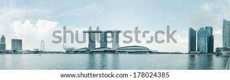 Singapore skyline of business district and Marina Bay in early morning light - stock photo