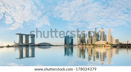 Singapore skyline of business district with skyscrapers and Marina Bay Sands at morning under blue sky - stock photo