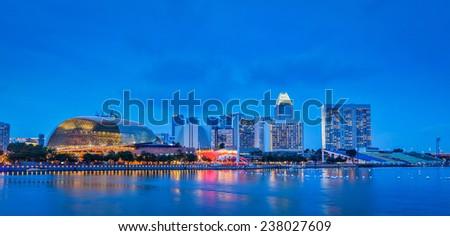 Singapore skyline panorama at Marina Bay in the evening - stock photo