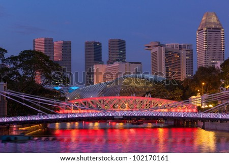 Singapore skyline. Singapore river and Cavenagh Bridge in the evening