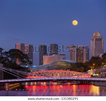 Singapore skyline. Singapore river and Cavenagh Bridge in the evening - stock photo