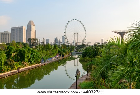 Singapore skyline view from tropical park at Gardens by the Bay with Singapore Flyer on background - stock photo
