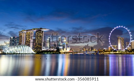 Singapore Skylines, Downtown and Financial District buildings reflection along the Singapore River at Blue Hour. Modern City Background. Urban night view. Panoramic style - stock photo