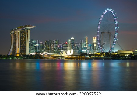 Singapore skyscraper in marina bay at night - stock photo