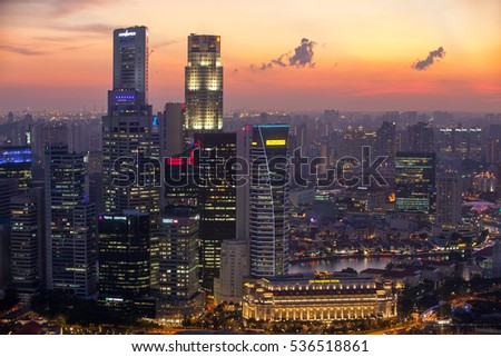 Singapore skyscrapers at sunset. View from above.    July 18, 2011