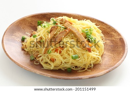 Singapore-style noodles, roasted pork and rice noodles stir frying - stock photo