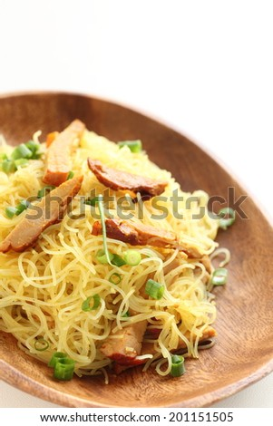 Singapore-style noodles, roasted pork and rice noodles stir frying
