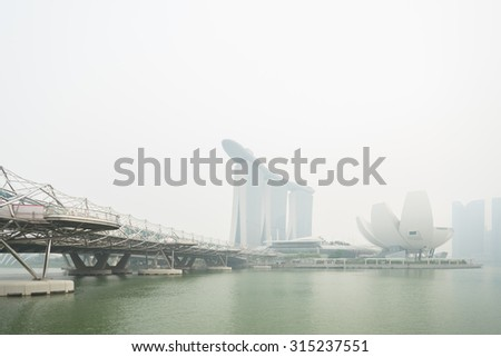 Singapore - 10th September, 2015: Haze fills the Marina Bay area. Haze is caused by the forest fire and burning of plantation in Indonesia.  - stock photo