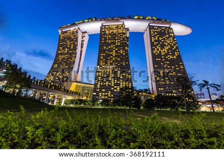 SINGAPORE:The Marina Bay Sands Resort April 15, 2015 in Singapore. The roofs of towers are decorated with a park in the form of a ship 340 m long and capacity up to 3,900 people.  - stock photo