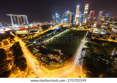Singapore view with urban skyscrapers at night.
