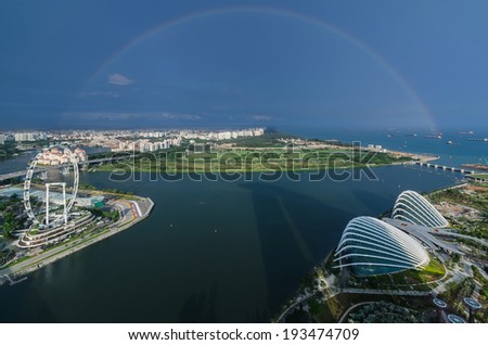 Singapore with rainbow  view from roof Marina Bay Hotel - stock photo