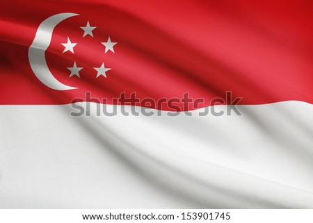 Singaporean flag blowing in the wind. Part of a series. - stock photo