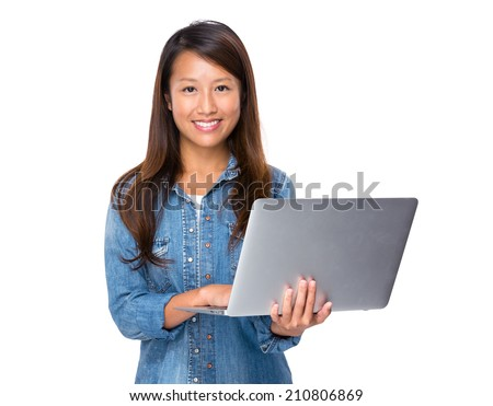 Singaporean woman use laptop computer computer - stock photo