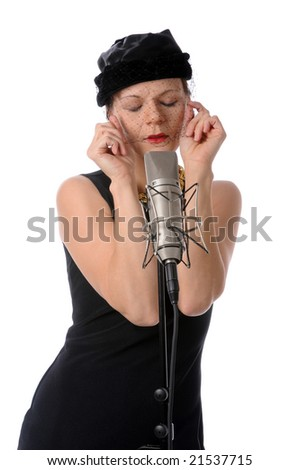 Singer in retro clothing singing into a vintage microphone