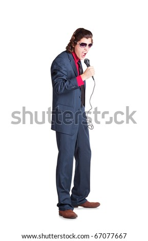 singer is singing  in grey suit and red shirt with microphone in white background