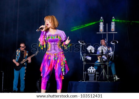 singer performs with her band - stock photo