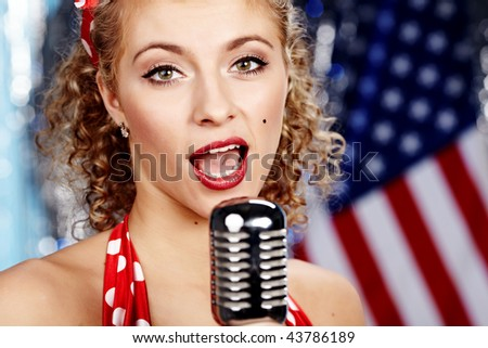 Singer woman, pin-up style - stock photo