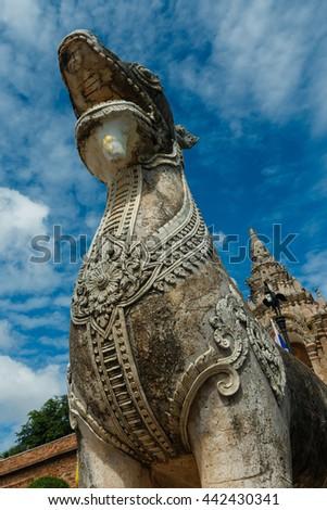 Singha statue at Wat Prathat Lampang Luang Temple, Lampang, Thailand - stock photo