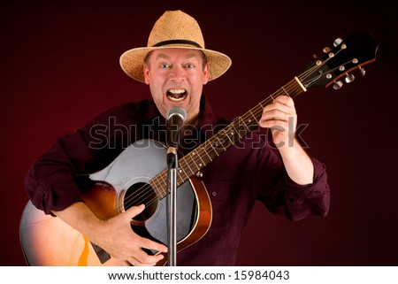 Singing and Playing Acoustic Guitar - stock photo
