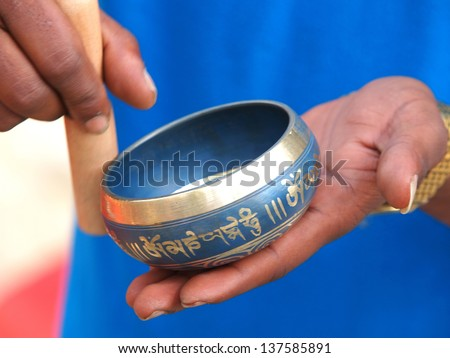 singing bowl in the hands of prayer - stock photo